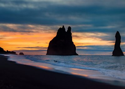 Sunrise at Reynisfjara, with the Reynisdrangar basalt sea stacks (that is not dust spots, they are birds!)